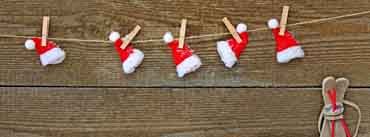 Santa Hats Attached To The Rope With Clothespin Cover Photo