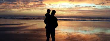 Father And Son At Sunset Beach Cover Photo
