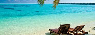 Deck Chairs On The Beach Cover Photo