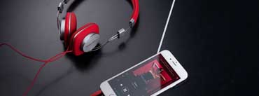 Red Headphone And White Iphone Cover Photo