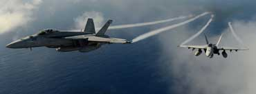 Military Aircrafts Flying Over Pacific Ocean Cover Photo